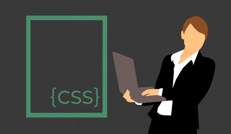 Grafika wektorowa przedstawiająca osobę z laptopem i tekst CSS w klamerkach